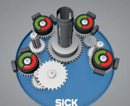 A multi-turn absolute encoder uses a simple gearing mechanism to tie the motion of the primary feedback disc with the secondary disc that monitors turns. (Courtesy of SICK).