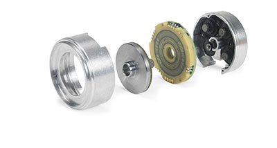 Exploded view of an inductive encoder shows lithographically patterned coils (second from right) and conductive disc (third from right). (Courtesy of Heidenhain)