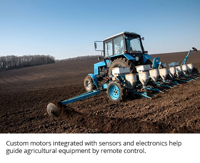 Custom motors integrated with sensors and electronics help guide agricultural equipment by remote control.