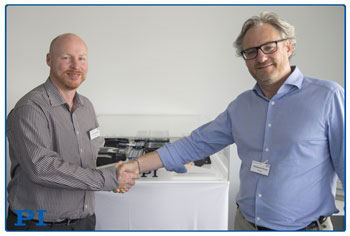 Stéphane Bussa (right), Vice President of Sales & Marketing, congratulates Dr. Cliff Jolliffe on his appointment to head PI's precision automation market segment