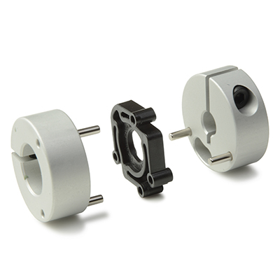 Controlflex couplings are comprised of two anodized aluminum hubs joined by pins to a Delrin frog